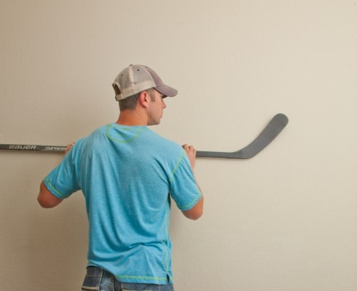 use our hockey stick hangers to mount horizontally or vertically on the wall