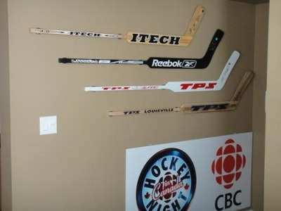 Steve Shields, Dominik Hasek, Roberto Luongo, and Furh/Moog/Ranford signed goalie sticks